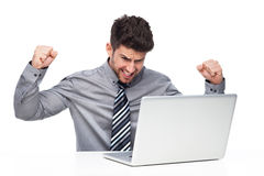 Angry man having problem with his laptop Royalty Free Stock Photo