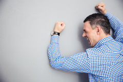 Angry man hitting wall Stock Image
