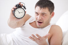 Angry man holding alarm clock Royalty Free Stock Photo
