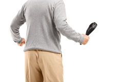 Angry man holding a belt, ready to beat someone Royalty Free Stock Photos
