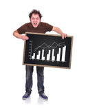 Angry man. Holding blackboard with chart Royalty Free Stock Image