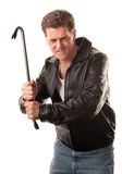 Angry man holding a crowbar. Angry man in leather jacket ready to strike with a crowbar stock images