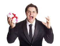 A angry man holding present box Royalty Free Stock Images
