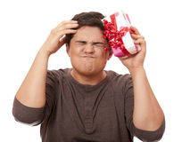 An angry man holding present box Stock Photo