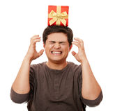 An angry man holding present box Royalty Free Stock Image