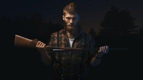 Angry man holding shotgun Stock Photo