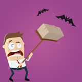 Angry man hunting bats with a broom Stock Photography