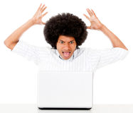 Angry man with a laptop Stock Image