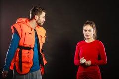 Angry man lifeguard shouting at woman lifesaver. Royalty Free Stock Images