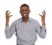 Angry man looking at the camera in distress Stock Images