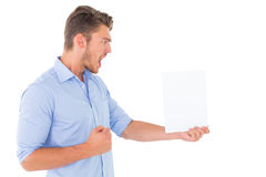 Angry man looking at page Royalty Free Stock Photography