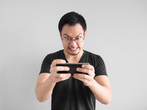 Angry man is losing the mobile game. royalty free stock photo