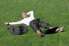Angry man lying on grass Royalty Free Stock Photo