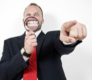 Angry man with magnified teeth Stock Image