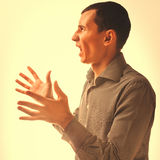 Angry man man brunette experiencing anger emotions, angry father Royalty Free Stock Images