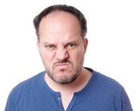 Angry man. Angry middle aged man with madman grimace Stock Images