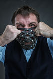 Angry man in muzzle Royalty Free Stock Photography