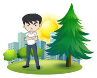 An angry man near the pine tree Royalty Free Stock Image