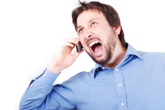 Angry man and phone Stock Photos