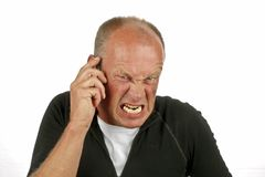 Angry man on the phone Royalty Free Stock Images