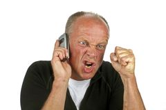 Angry man on the phone. On a white background Royalty Free Stock Photography