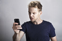 Angry man with phone Royalty Free Stock Images