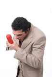Angry man on the phone. An angry man shouting on the phone, isolated on white Royalty Free Stock Photography