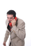Angry man on the phone. An angry man shouting on the phone, isolated on white Stock Photo