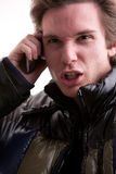 Angry man on phone in winter Royalty Free Stock Images