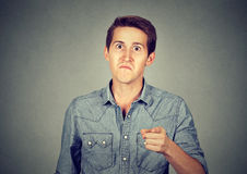 Angry man pointing his finger accusing someone Stock Photos