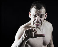 Angry man pointing to camera Stock Images