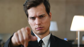 Angry Man Pointing toward Camera with Finger Stock Images