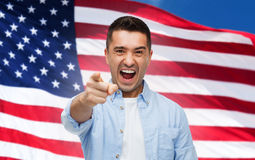 Angry man pointing on you over american flag Stock Image