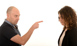 Angry man pointing at young woman Stock Photos