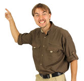 Angry man points by his hand on the board behind him Royalty Free Stock Photography