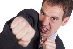 Angry Man Punching Stock Photography