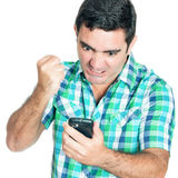 Angry man punching his mobile phone Royalty Free Stock Photos