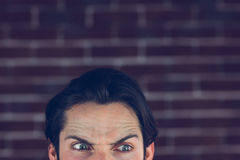 Angry man with raised eyebrows looking away Stock Images