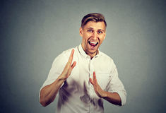 Angry man raising hands in air attack with karate chop Stock Photo