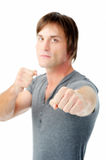 Angry man ready to fight. Scary man with fists clenched boxing towards camera showing aggression Royalty Free Stock Image