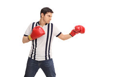 Angry man with red boxing gloves Stock Photography