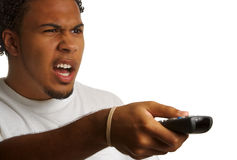 Angry man with remote Royalty Free Stock Images