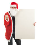 Angry man in Santa clothes with billboard Royalty Free Stock Photography