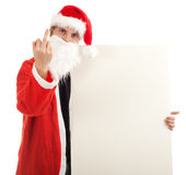 Angry man in Santa clothes with billboard Royalty Free Stock Photo