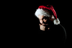 Angry man in Santa hat Royalty Free Stock Photography