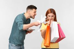 Angry man scolding his wife who has spent royalty free stock photos