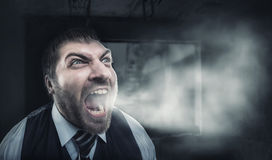 Angry man screaming Stock Images