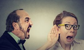 Angry Man Screaming Curious Woman With Hand To Ear Gesture Listens Stock Image