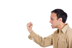 Angry man screaming, with fist in air Royalty Free Stock Photography