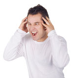 Angry man screaming isolated over white. Background stock photo
